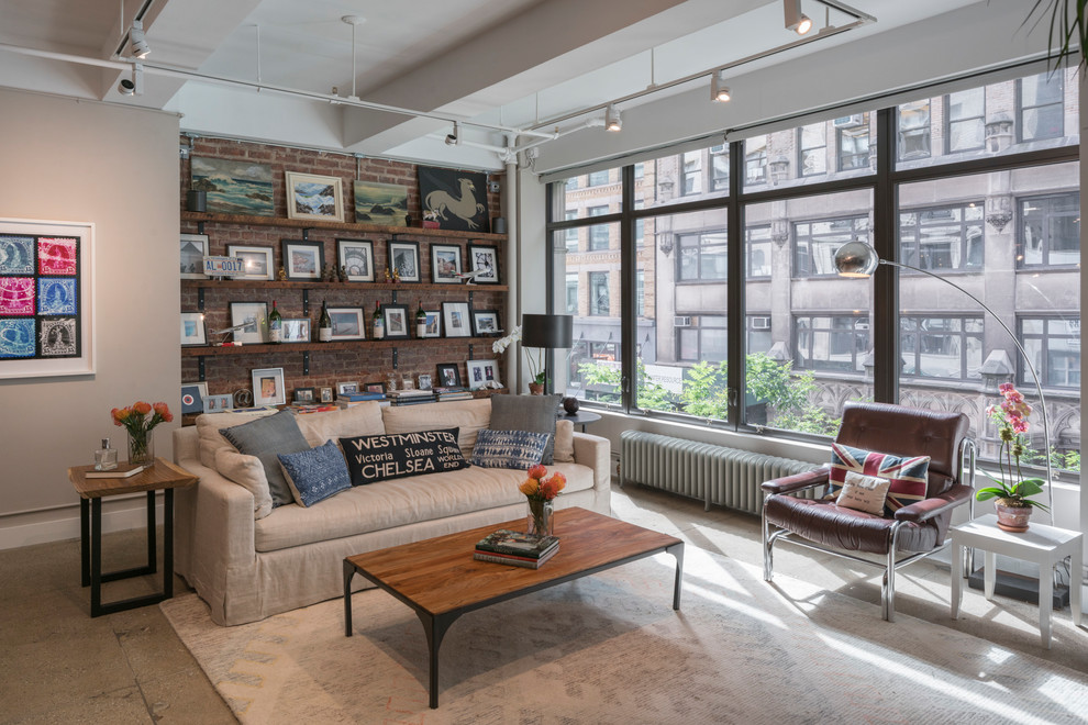 Example of an urban concrete floor and gray floor family room design in New York with gray walls