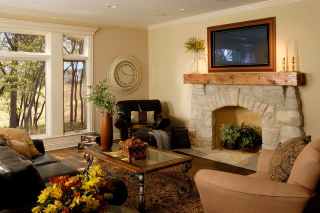 Mid-sized elegant open concept medium tone wood floor family room photo in Chicago with a stone fireplace, beige walls, a standard fireplace and a wall-mounted tv