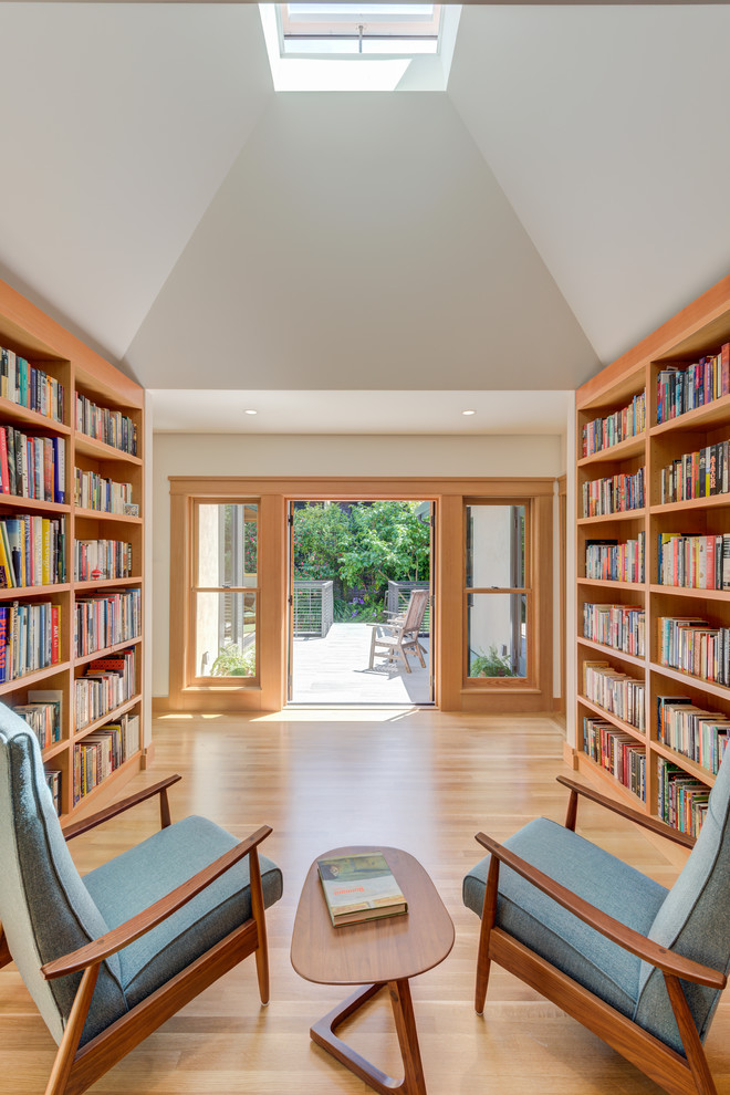 Arts and crafts light wood floor and beige floor family room library photo in San Francisco with white walls