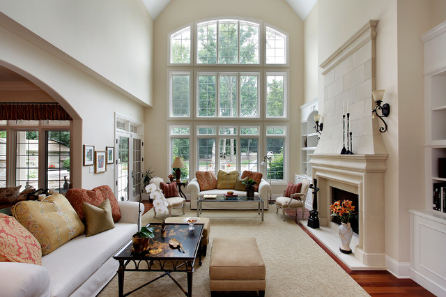 Elegant dark wood floor family room photo in Denver with a stone fireplace