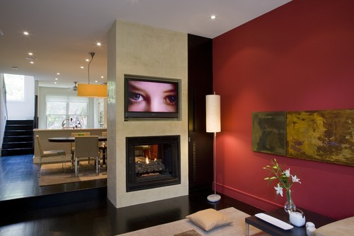 sala familiar con paredes rojas