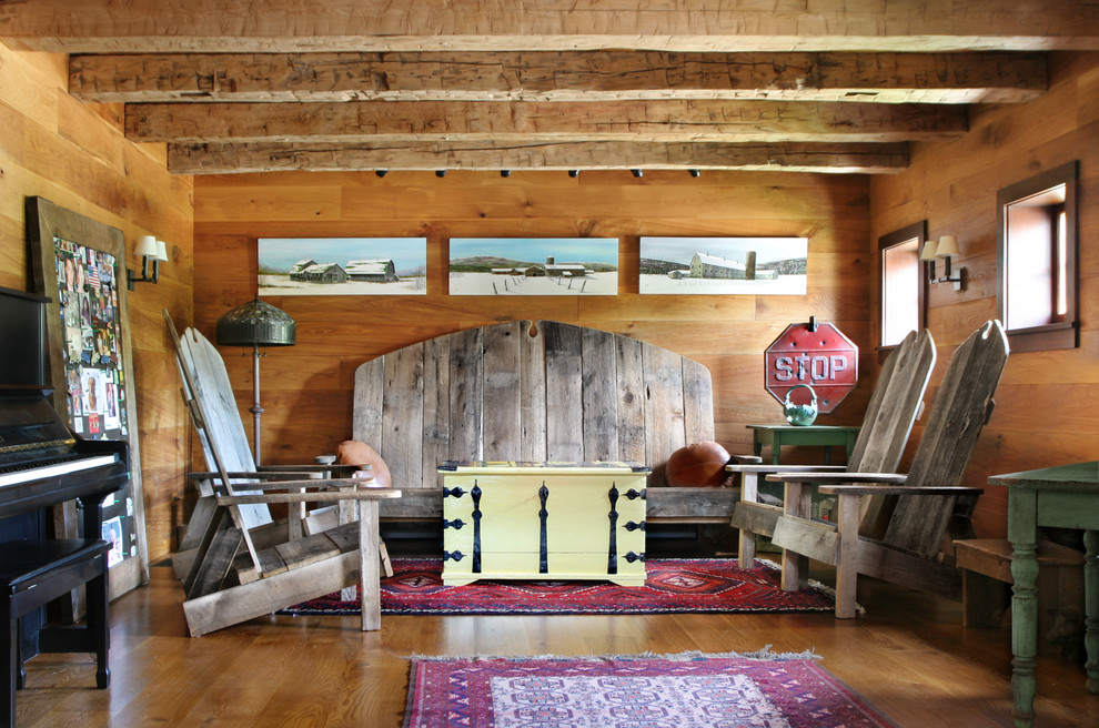 Family room - mid-sized cottage enclosed medium tone wood floor family room idea in New York with brown walls