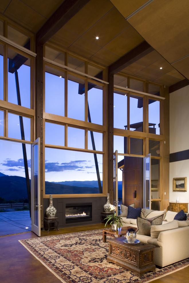 Example of a trendy concrete floor family room design in Denver