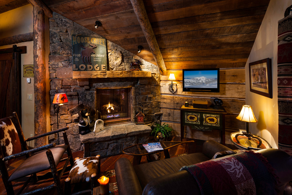 Example of a mountain style family room design in Other with a corner fireplace