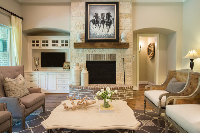 Traditional medium tone wood floor family room idea in Houston with beige  walls, a standard