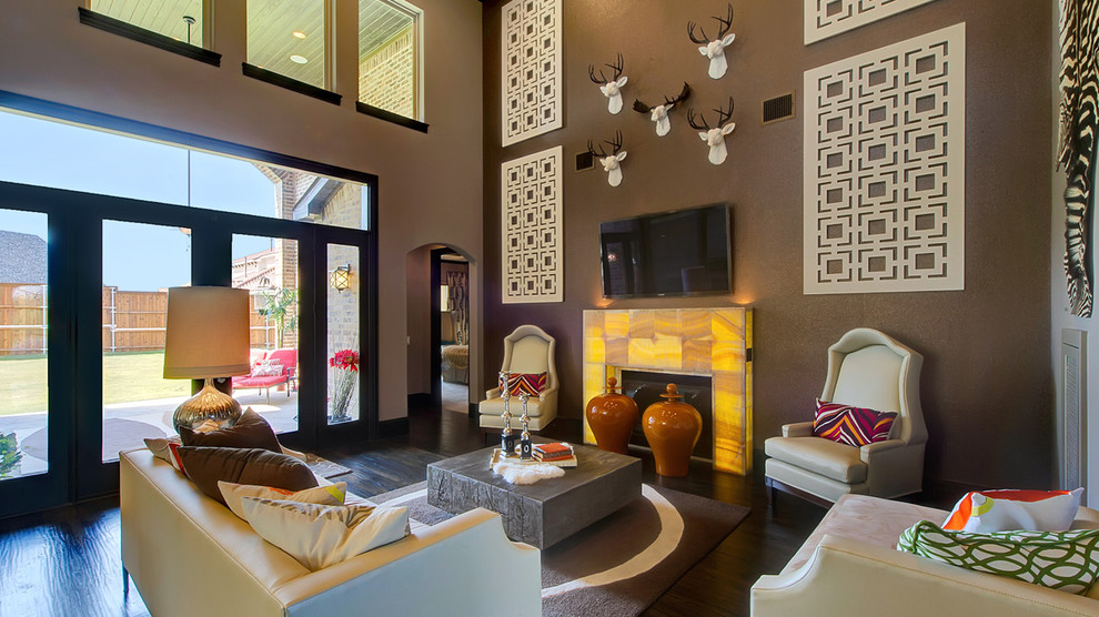 Trendy open concept dark wood floor family room photo in Dallas with brown walls, a standard fireplace and a wall-mounted tv
