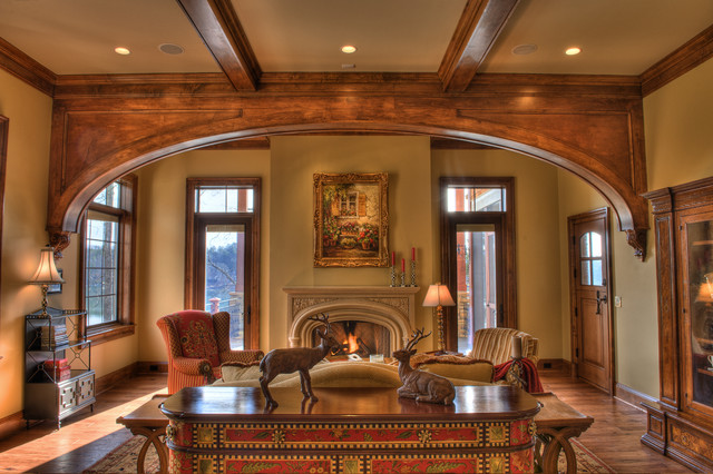 Gabriel builders rustic family room other metro by for Wooden arch designs in living room