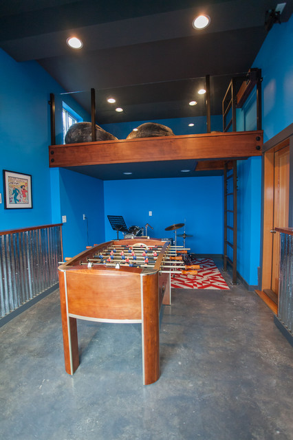 Garage turned game room industrial family room for Garage game room