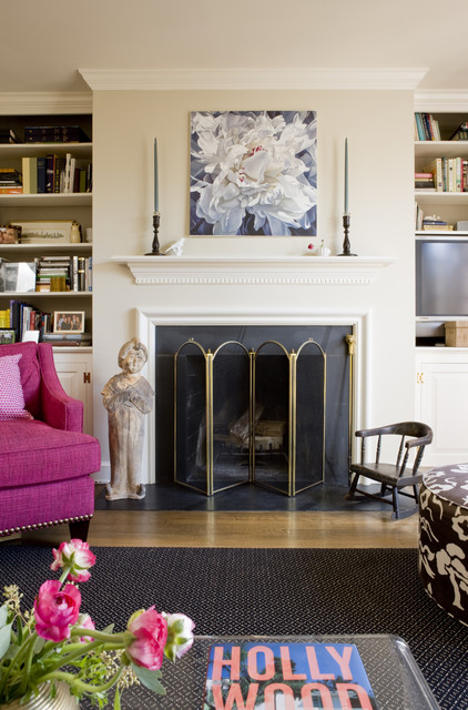 Family room - transitional medium tone wood floor family room idea in DC Metro with beige walls and a standard fireplace