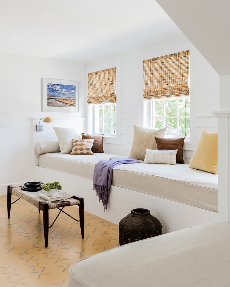 Inspiration for a coastal multicolored floor family room remodel with white walls