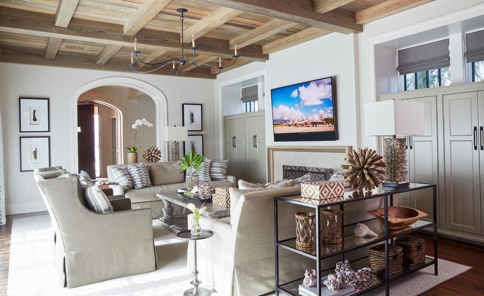 Beach style medium tone wood floor and brown floor family room photo in Other with white walls, a standard fireplace and a wall-mounted tv