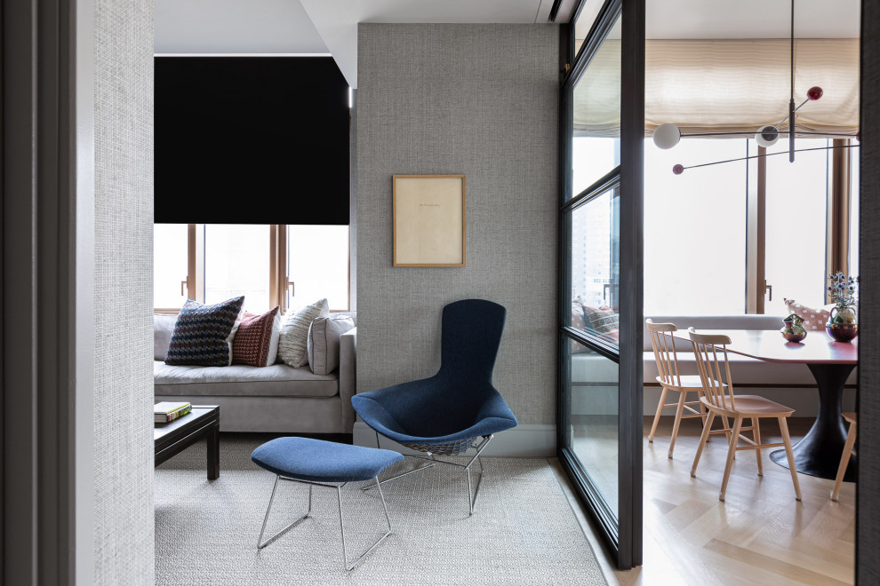 Inspiration for a contemporary enclosed carpeted, gray floor and wallpaper family room remodel in New York with gray walls