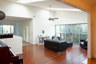 Grange queenslander remodel traditional family room for Queenslander living room ideas