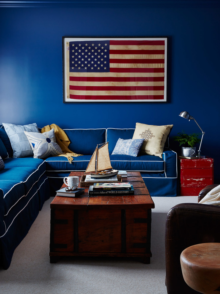 Inspiration for a coastal family room remodel in Jacksonville with blue walls