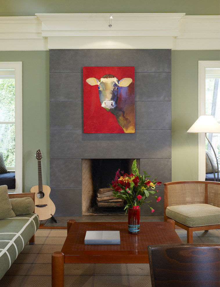 Example of an eclectic family room design in DC Metro with a concrete fireplace and green walls
