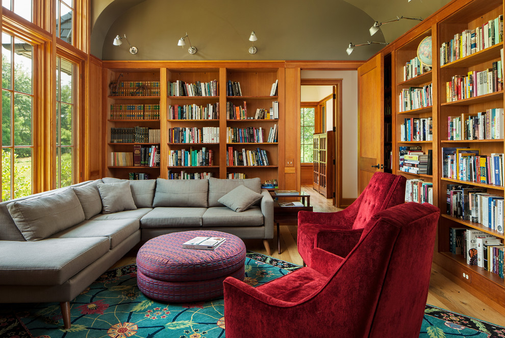 Family room library - craftsman enclosed light wood floor family room library idea in Wilmington with green walls