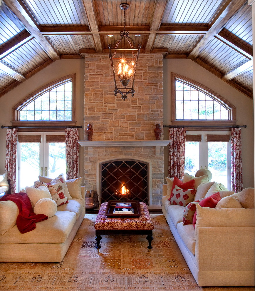 Elegant family room photo in New York with a stone fireplace