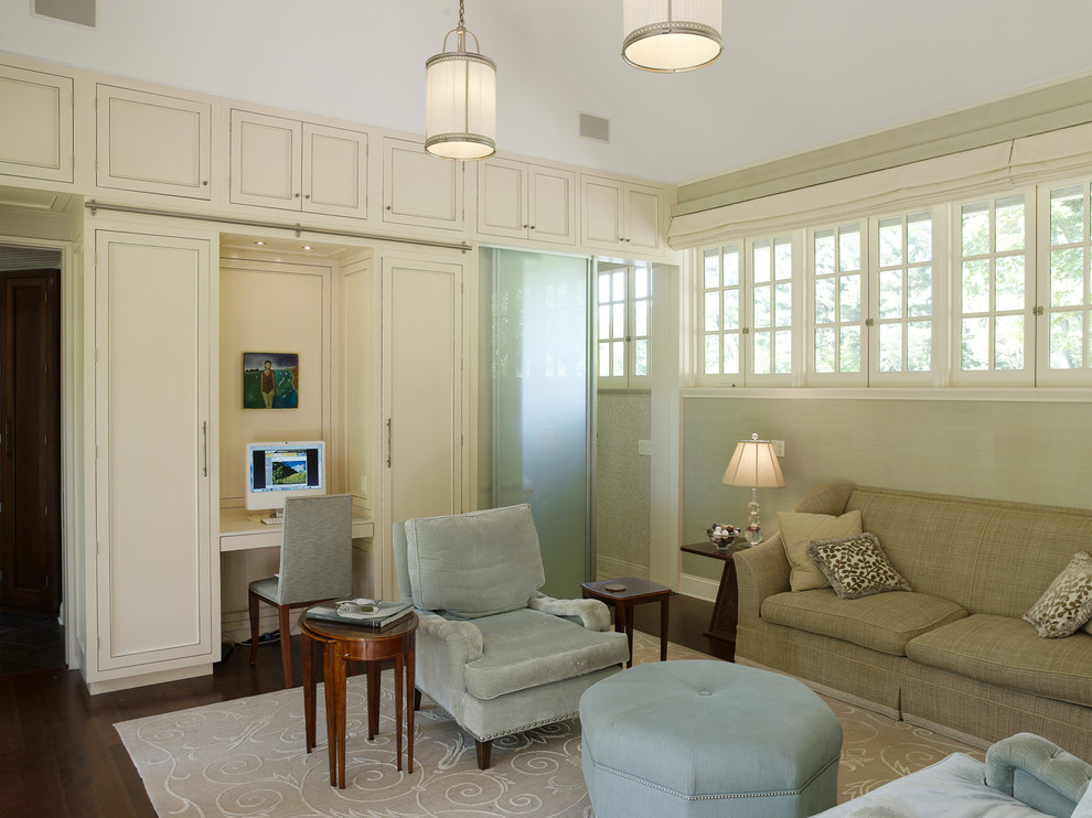 Inspiration for a contemporary enclosed dark wood floor family room remodel in New York with beige walls