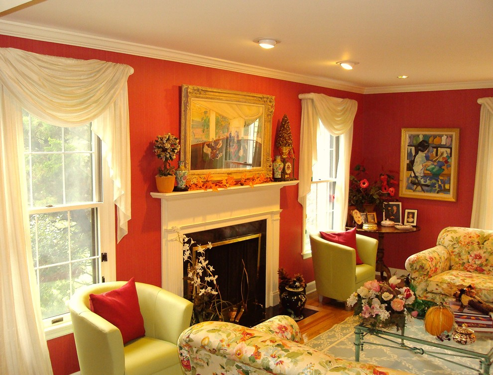 Inspiration for a mid-sized timeless open concept medium tone wood floor and brown floor family room remodel in New York with red walls, a standard fireplace, a wood fireplace surround and no tv