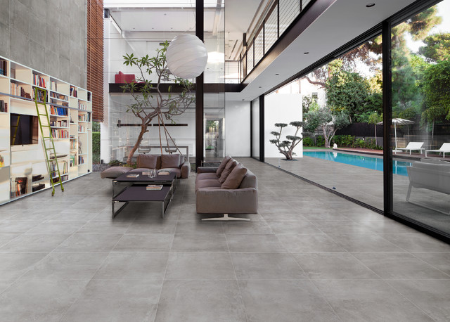 Grey Concrete Look Tile Industrial Family Room