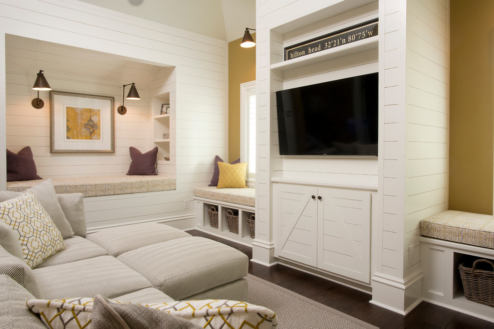 Example of a beach style dark wood floor family room design in Atlanta with a wall-mounted tv