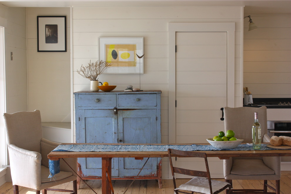 Inspiration for a rustic medium tone wood floor family room remodel in Portland Maine with beige walls