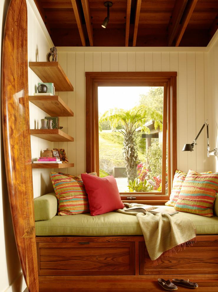 Family room - tropical medium tone wood floor family room idea in Hawaii with beige walls