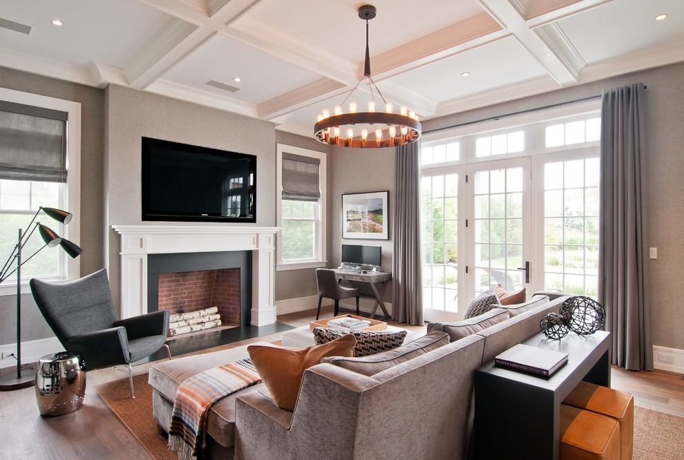 Family room - transitional family room idea in New York with gray walls, a standard fireplace and a wall-mounted tv