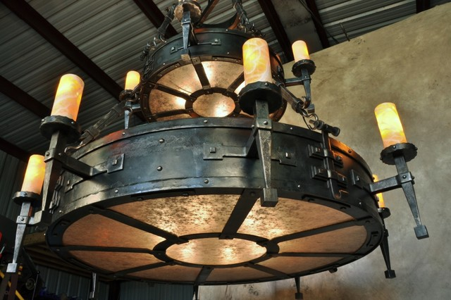 Hand forged chandelier rustic family room new orleans by hand forged chandelier rustic family room aloadofball Images