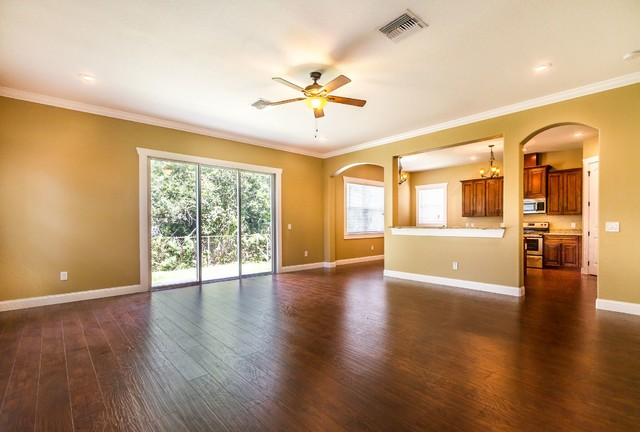 Example of a coastal family room design in Tampa