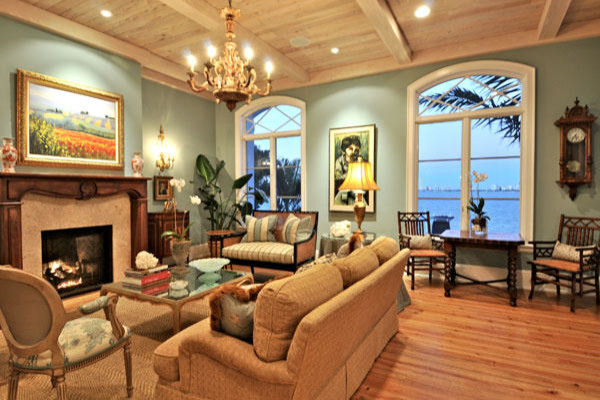 Large coastal open concept light wood floor family room photo in Tampa with blue walls, a standard fireplace and no tv