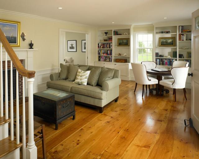 midsized farmhouse enclosed medium tone wood floor and orange floor family room idea in