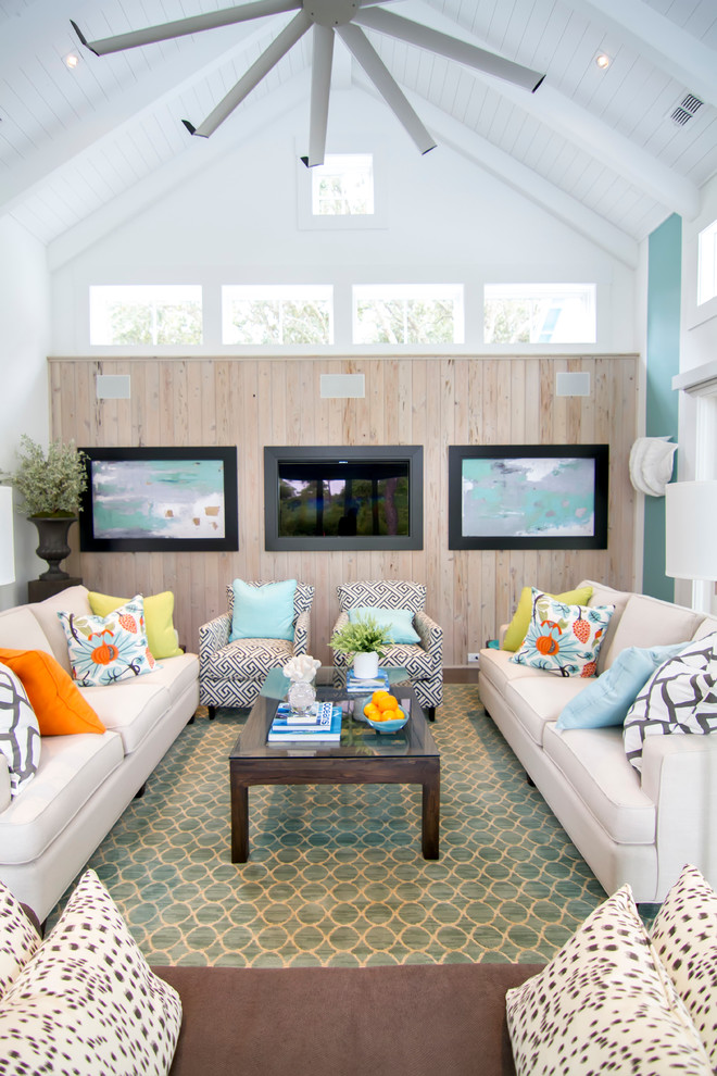 Inspiration for a large tropical open concept medium tone wood floor and brown floor family room remodel in Jacksonville with a wall-mounted tv and multicolored walls