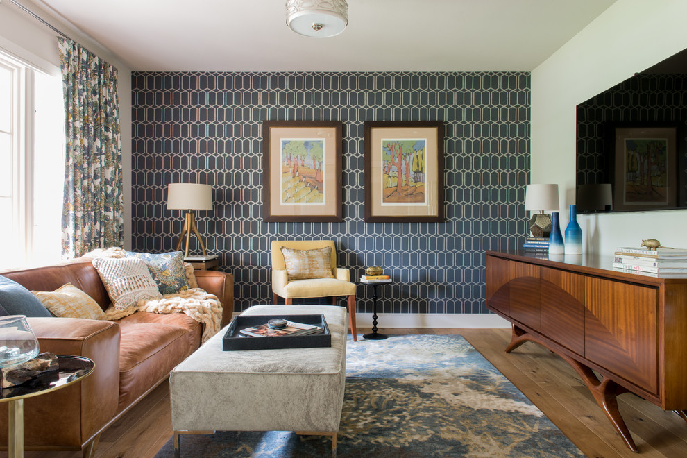 Mid-sized 1960s medium tone wood floor family room photo in Austin with a wall-mounted tv and multicolored walls