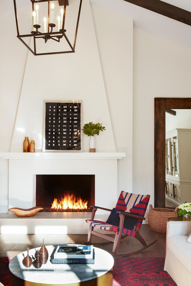 Inspiration for a mediterranean dark wood floor family room remodel in San Francisco with a plaster fireplace