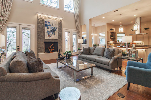 Example of a large trendy medium tone wood floor family room design in Dallas with gray walls and a standard fireplace