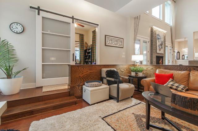 Family room - contemporary open concept medium tone wood floor family room idea in Dallas