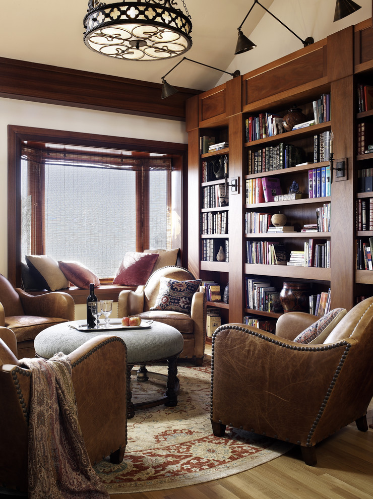 Example of a classic family room library design in San Diego