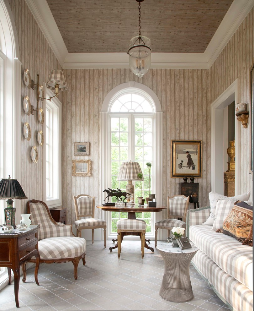Family room - traditional enclosed family room idea in Houston with beige walls