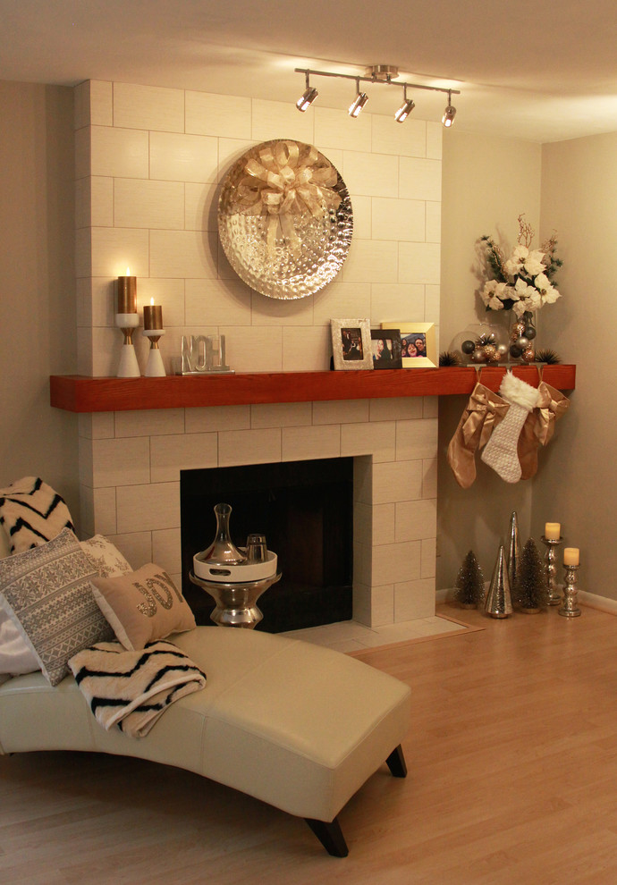 Family room - small modern open concept light wood floor family room idea in Richmond with beige walls, a standard fireplace and a tile fireplace