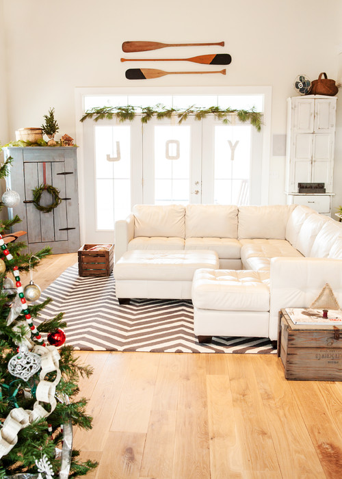 a tree, wreath, garland and ornaments in a clean white spaces