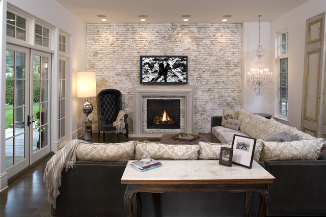 Example Of A Tuscan Family Room Design In Minneapolis With Brick Fireplace