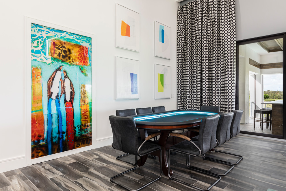 Trendy brown floor game room photo in Orlando with white walls and no fireplace
