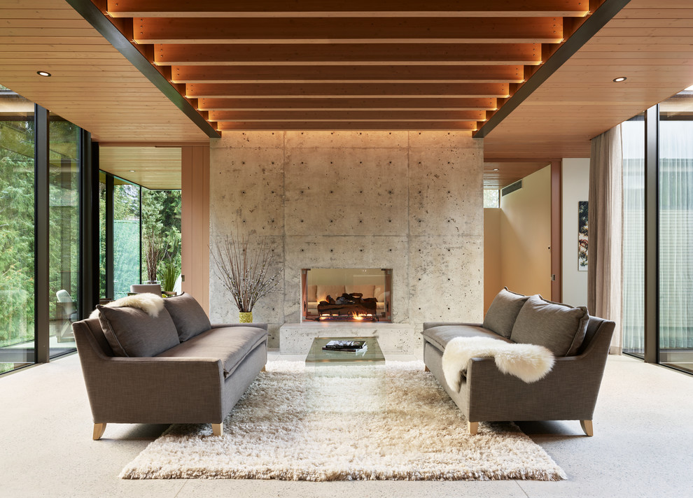 Inspiration for a modern open concept family room remodel in Seattle with gray walls, a two-sided fireplace and a concrete fireplace