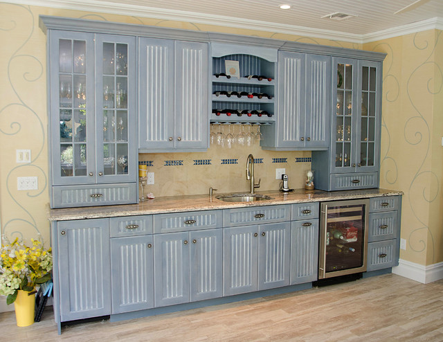 Huge wet bar wall unit traditional family room for Kitchen units design ideas
