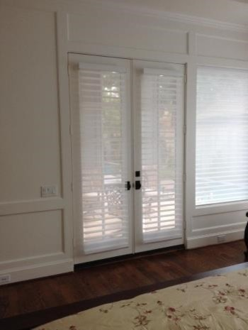 roman shades french doors family room with area rug