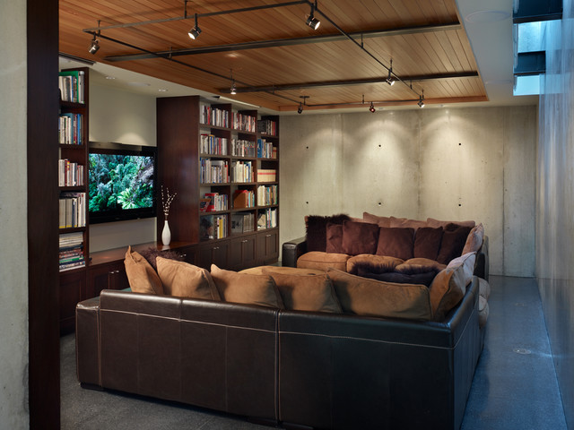 Inspiration For An Industrial Gray Floor Home Theater Remodel In Seattle Part 44