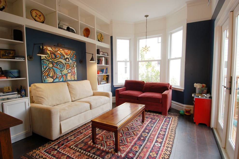 Example of an eclectic dark wood floor family room design in San Francisco with blue walls