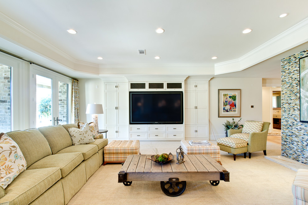 Family room - large transitional carpeted family room idea in Atlanta with beige walls and a media wall