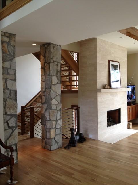 Interior stone columns amp travertine fireplace traditional living room
